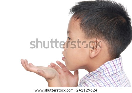 Close up little kid holding something on the palm of her hand - stock photo