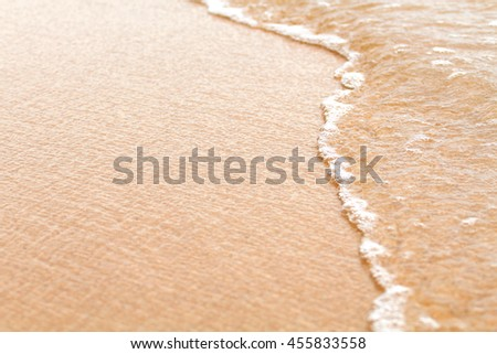Close up little white sea bubble and sand pattern on the beach - stock photo