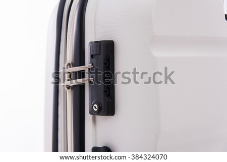 Close up lock on white luggage.