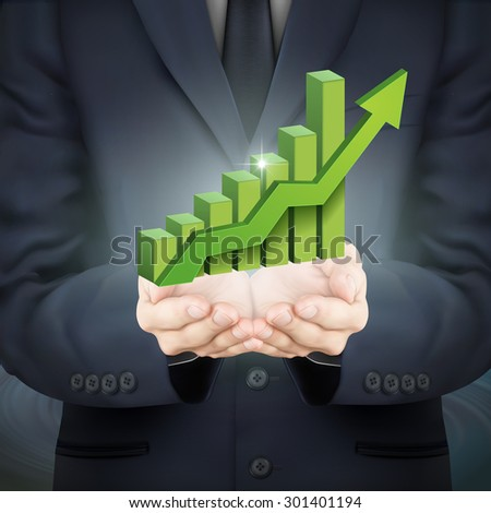 close-up look at businessman holding a bar graph with rising arrow