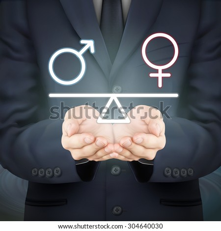 close-up look at businessman holding male and female symbol seesaw - stock photo