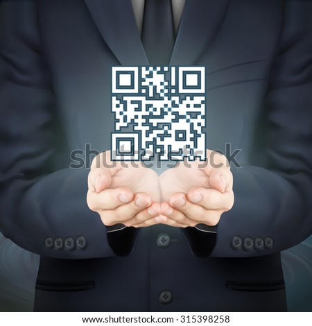 close-up look at businessman holding QR code icon - stock photo