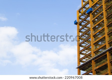 close up look at construction site over blue sky - stock photo