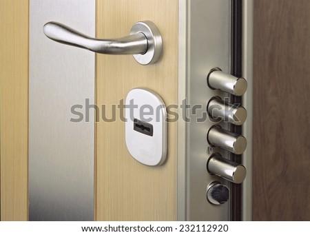 Close-up look at home door high security lock - stock photo