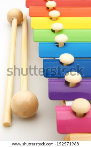 close up look of colorful xylophone and sticks, vertical - stock photo