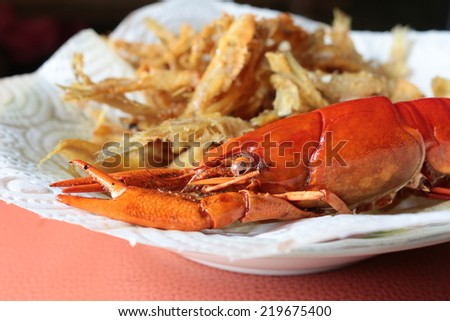 close-up macro boiled crawfish or crayfish  and fish fried of lobster farm market on the plate - stock photo