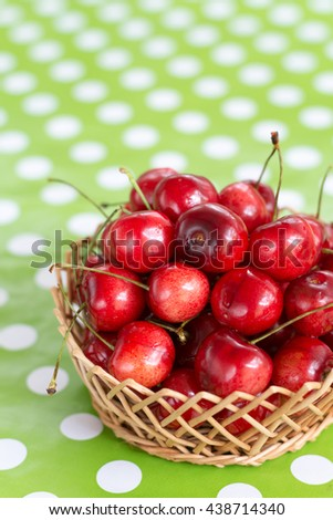 Close up macro cherries in the basket