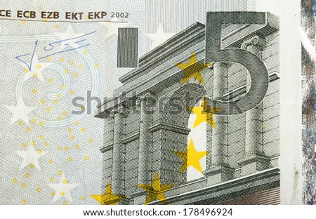 close up macro detail of fifth euro money banknote - stock photo