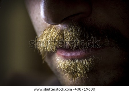 Close up macro dramatic serious mustache and facial hair - stock photo