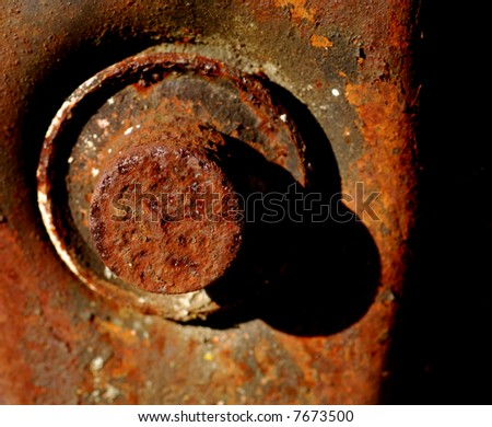 Close up macro image of rusted bolt with patina