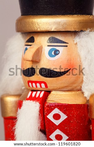 Close Up Macro Of A Carved Wooden Christmas Nutcracker Military Figure - stock photo