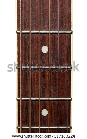 Close up macro of guitar strings and fret board - stock photo