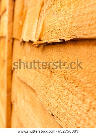 close up macro of orange tinted wood fence texture for garden
