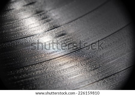 Close up magnification of a vinyl record - stock photo