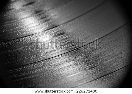 Close up magnification of a vinyl record in black and white - stock photo