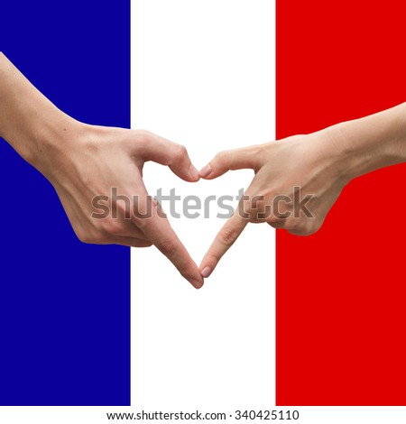 close up male and female hands making heart on France flag backgrounds.pray for Paris concept: strong together conceptual:assistance and support.strength and support conception. - stock photo