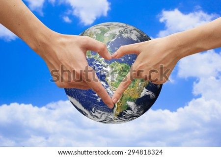 close up male and female hands making heart shape over the world.safe the world concept.love the world concept.Elements of this image furnished by NASA - stock photo