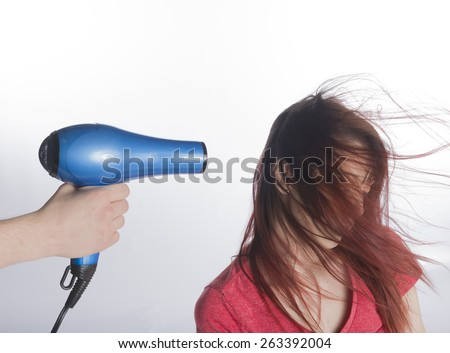 Close up Man Hand Holding Blow Dyer Drying the Long Hair of a Woman, Isolated on White Background. - stock photo