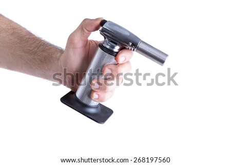 Close up Man Hand Holding Butane Kitchen Torch, Ready to Ignite.Isolated on White Background. - stock photo