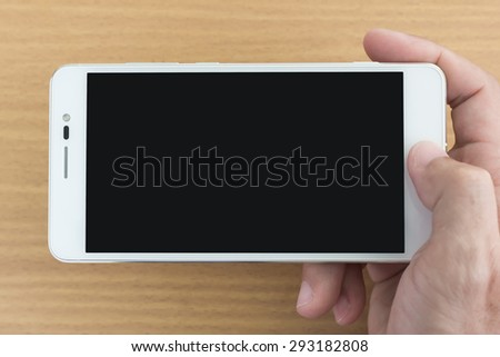 Close up man hand touching on smart phone - stock photo