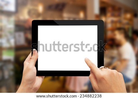 Close up man hands with ring using  blank tablet  on restaurant  background - stock photo