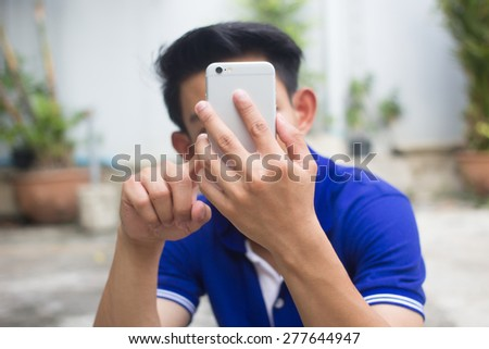 close up man playing smart phone , soft focused, selective focused , smart phone addict concept