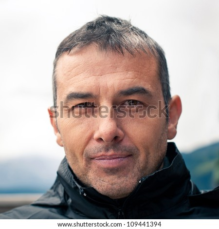 Close up man portrait outdoor. - stock photo