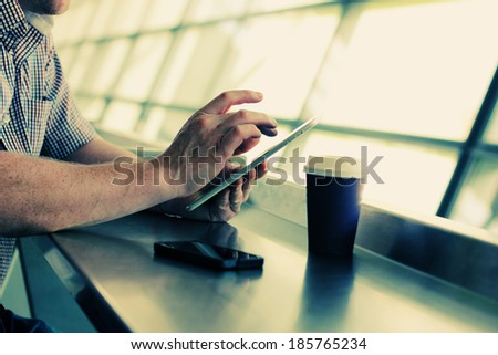 close up man's hands with tablet - stock photo