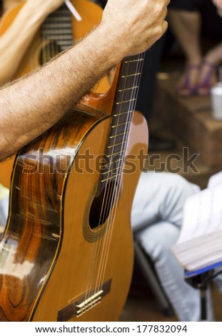 Close up - man with guitar - track that features music - Choro and Samba in the public square - Rio de Janeiro