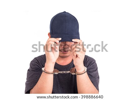 Close up man with handcuffs on hands isolated on white background - stock photo