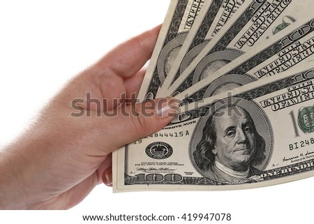 close up Many dollars falling on woman's hand with money - stock photo