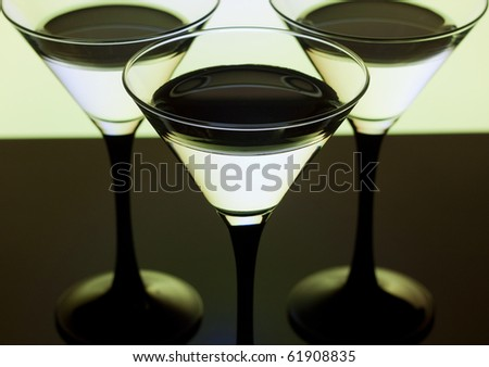 Close up martini glass for cocktails on a yellow background