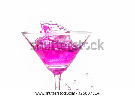 close up martini glass with pink cocktail on white background - stock photo