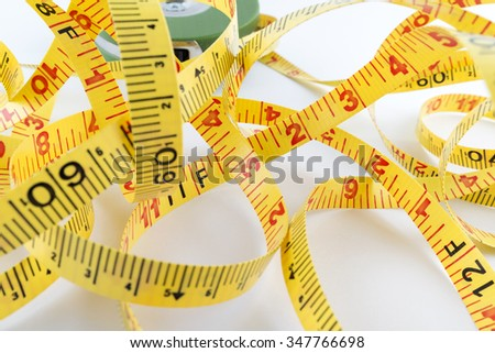 Close up, Measuring tape on white table - stock photo