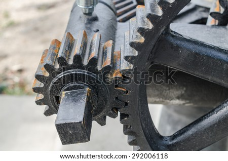 close-up mechanical gear with a large toothed wheel of Floodgate valve with color Effect - stock photo
