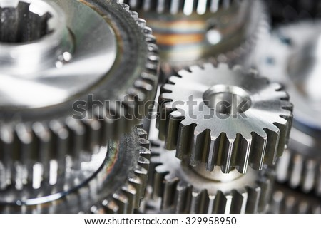 close-up metal cog wheels gears - stock photo