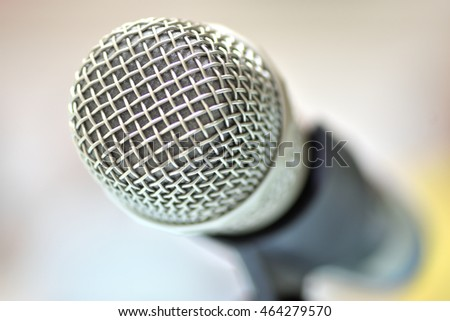 Close-up microphone and selective focus with abstract background.