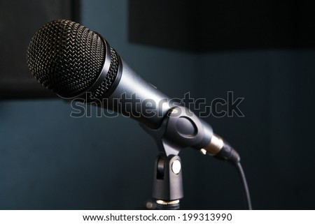 close-up Microphone on stage with dark background