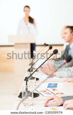 close-up microphone, on the background of business communication at the conference - stock photo
