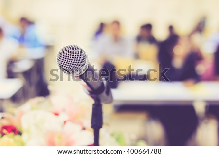 Close up microphone on the desk in meeting room with blur people background, With vintage filter effect - stock photo