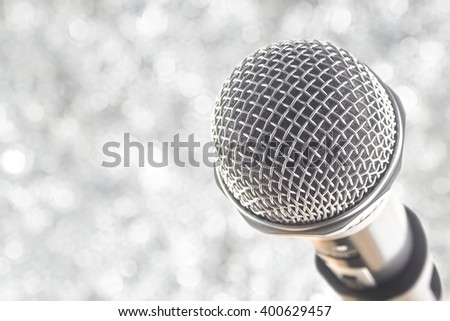 close up microphone on white bokeh background abstract