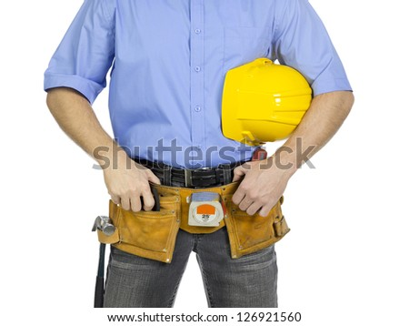 Close-up mid section of a service man with yellow hard hat and wearing tool belt around waist - stock photo