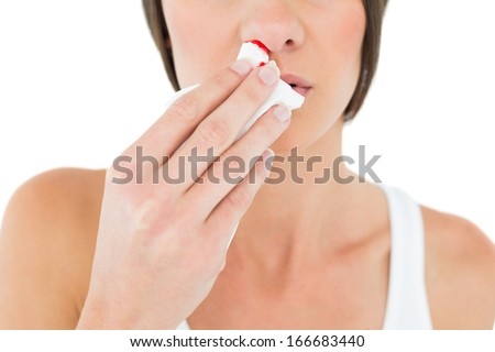 Close-up mid section of a young woman with bleeding nose over white background - stock photo