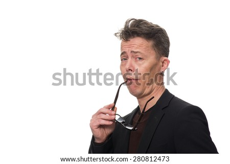Close up Middle Age Businessman, Holding his Eyeglasses, Showing Dismissive Shrug While Looking at the Camera. Isolated on White Background.
