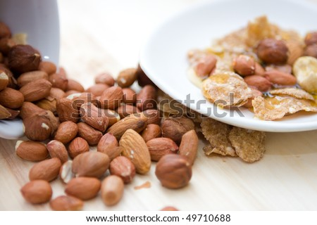 close up mix of nuts with honey - stock photo