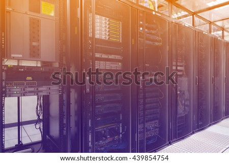 Close up modern interior of server room, Super Computer, Data center with abstract color effect. - stock photo