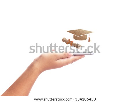 Close up modern mobile phone in the hand with graduation cap and diploma scroll made of brown fabric texture isolated on white background. E-learning Education, Internet Library concept. - stock photo