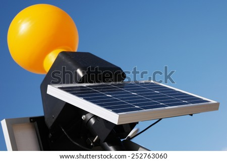 Close up Modern Solar Panel Technology, Acquiring Energy from the Sun, with Blue Sky Background - stock photo