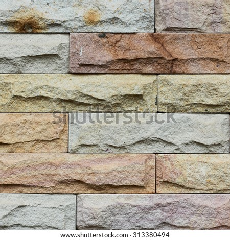 Close up modern stone brick wall surfaced. - stock photo