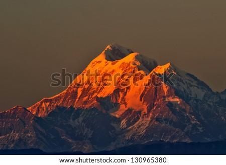 "close up mountain ""Trishul"" during sunset in Indian Himalaya - stock photo"